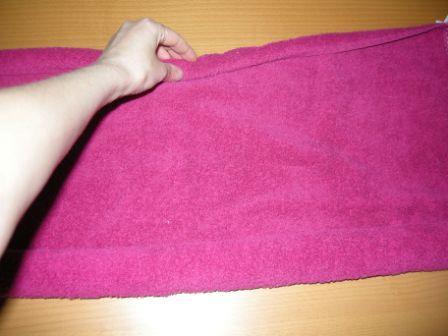 Handtuch beidseitig einrollen